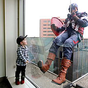 Silas Elam, 3, of Toledo, looks up toward Captain America, portrayed by Patrolman Robert Orwig, during the Halloween superhero event at ProMedica Toledo ChildrenÕs Hospital in Toledo on Tuesday, October 30, 2018. Toledo Police Department SWAT team members dressed as superheroes rappelled down the side of the hospital in front of the pediatric level of the hospital. THE BLADE/KURT STEISS