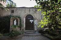 ROME, ITALY - 26 AUGUST 2016: The entrance of the Mother House of the Missionaries of Charity, the religious congregation founded by Mother Teresa in 1950, is seen here in Rome, Italy, on August 26th 2016.<br /> <br /> Mother Teresa, also known as Blessed Teresa of Calcutta, was an Albanian Roman Catholic nun and missionary. She founded the Missionaries of Charity, a Roman Catholic religious congregation, whose members must adhere to the vows of chastity, poverty, and obedience, as well as the vow to give wholehearted free service to the poorest of the poor. Shortly after she died in 1997, Pope John Paul II waived the usual five-year waiting period and allowed the opening of the process to declare her sainthood. She was beatified in 2003. A second miracle was credited to her intercession by Pope Francis, in December 2015, paving the way for her to be recognised as a saint by the Roman Catholic Church. Her canonisation is scheduled for September 4th 2016, a day before the 19th anniversary of her death.