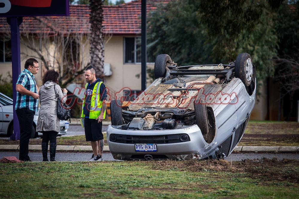 Mazda rolled over outside Mount Henry Tavern, Como, Western Australia.