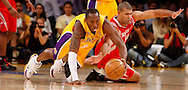 epa01161244 Kobe Bryant (L) of  the Los Angeles Lakers and Shane Battier of the Houston Rockets dive for a loose ball in the first quarter  at the Staples Center in Los Angeles, California , USA, 10 October 2007.  EPA/ANDREW GOMBERT CHINA OUT