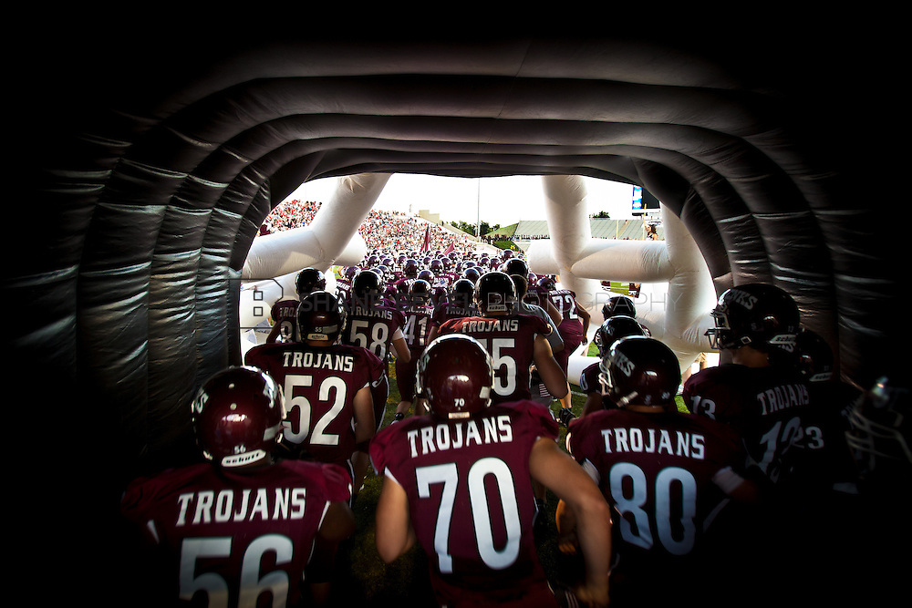9/9/11 7:07:05 PM -- Backyard Bowl. The Jenks Trojans take the field against the Union Redskins during the Jenks vs. Union game at University of Tulsa. <br /> <br /> Photo by Shane Bevel