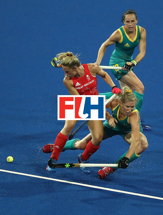RIO DE JANEIRO, BRAZIL - AUGUST 06:  Susannah Townsend #9 of Great Britain collides with Jodie Kenny #7 and Madonna Blyth #12 of Australia during a Women's Pool B match between Australia and Great Britain on Day 1 of the Rio 2016 Olympic Games at the Olympic Hockey Centre on August 6, 2016 in Rio de Janeiro, Brazil.  (Photo by Sean M. Haffey/Getty Images)