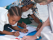 Nusery school children at Saateni nursery school, pictured with VSO volunteer, Daphne Sharpe who is working as a teacher trainer. Daphne has now trained over 100 nusery school teachers and 18 heads of pre school.