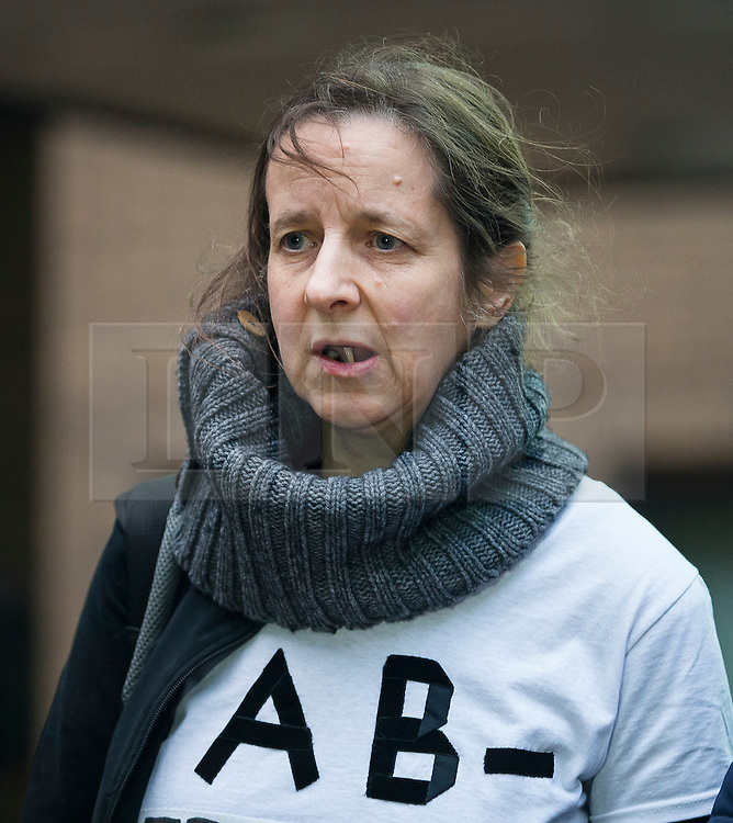 """© Licensed to London News Pictures. 29/01/2016. London, UK. JOSEPHINE HERIVEL wearing a t-shirt with the words """"A B - FRAMED BY BRITISH STATE""""  written on it as she leaves Southwark Crown Court in London where Maoist cult leader Aravindan Balakrishnan has been sentenced to 23 years in prison for rape, child cruelty and false imprisonment. Aravindan Balakrishnan was found guilty of the rape of two of his followers and and false imprisonment of  his daughter for more than 30 years in a commune in south London.  Photo credit: Peter Macdiarmid/LNP"""