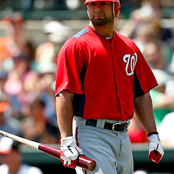 March 24, 2012; Sarasota, FL, USA; Washington Nationals catcher Jesus Flores (26) reacts after being called out on strikes during the top of the first inning of a spring training game against the Baltimore Orioles at Ed Smith Stadium.  Mandatory Credit: Derick E. Hingle-US PRESSWIRE
