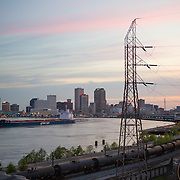 View of the Mississippi River and downtown/French Quarter area at sunset from the Bywater neighborhood.