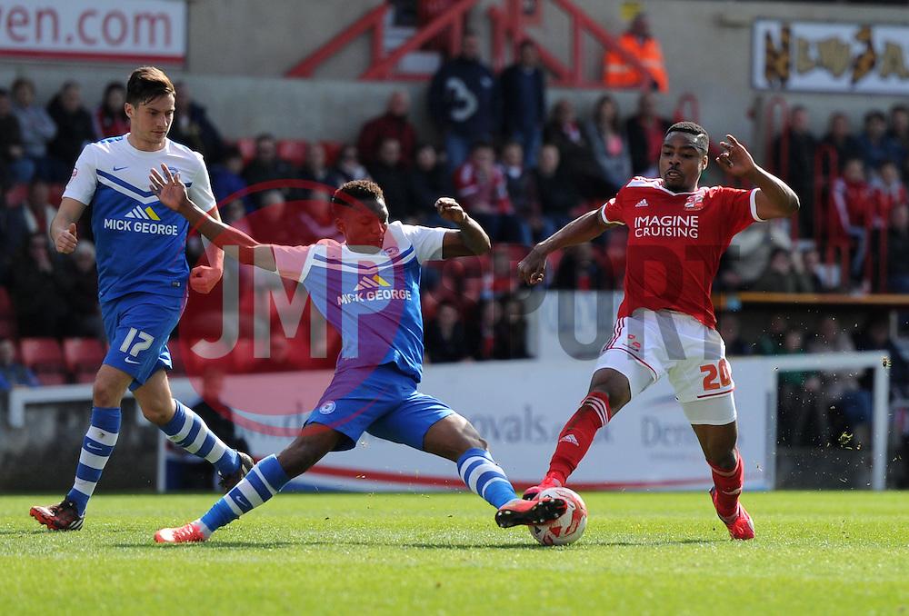 Peterborough United's Kgosi Ntlhe intercepts Swindon Town's Jon Obika - Photo mandatory by-line: Paul Knight/JMP - Mobile: 07966 386802 - 11/04/2015 - SPORT - Football - Swindon - The County Ground - Swindon Town v Peterborough United - Sky Bet League One