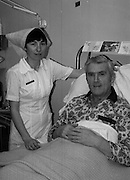 15/02/1984<br /> 02/15/1984<br /> 15 February 1984<br /> Cork hurling coach, Johnny Clifford, recovering in the Mater Hospital in Dublin. <br /> In this picture, Clifford is attended by Nurse Una O'Mahony, Rathkeale, Co. Limerick.