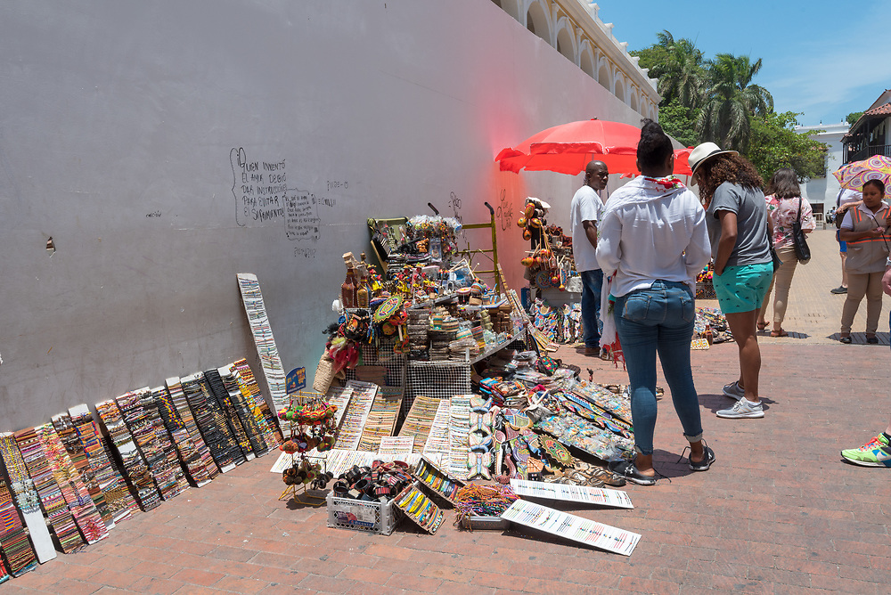 Cartagena, Columbia -- April 21, 2018. Street merchants display wares for sale on the street in Cartagena, Columbia.  Editorial use only.