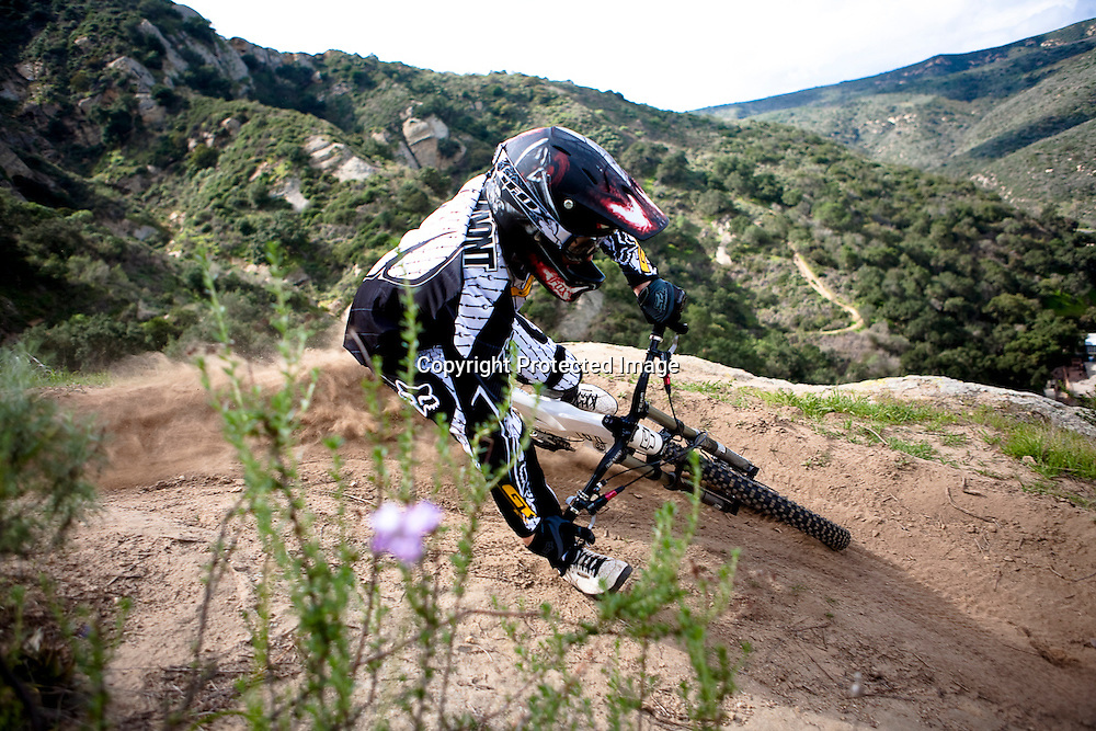 Marc Beaumont rails a berm on the PG trail high above Laguna Canyon road in Orange County, California.