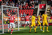 Olayinka Fredrick Oladotun Ladapo of Rotherham United celebrating his team's forth goal during the EFL Sky Bet League 1 match between Rotherham United and Bolton Wanderers at the AESSEAL New York Stadium, Rotherham, England on 14 September 2019.