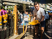 19 AUGUST 2015 - BANGKOK, THAILAND: A man who lost family members in the terror bombing of Erawan Shrine prays during the reopening of the shrine. Erawan Shrine in Bangkok reopened Wednesday morning after more than 20 people were killed and more than 100 injured in a bombing at the shrine Monday, August 17, 2015. The shrine is a popular tourist attraction in the center of Bangkok's high end shopping district and is an important religious site for Thais. No one has claimed responsibility for the bombing.       PHOTO BY JACK KURTZ