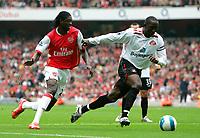 Photo: Tom Dulat.<br /> Arsenal v Sunderland. The FA Barclays Premiership. 07/10/2007.<br /> Dwight Yorke of Sunderland and Emmanuel Adebayor of Arsenal with the ball