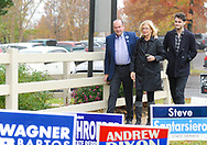 Scott Wallace walks with his arm around his wife Christy Wallace along with their son Robert Wallace as the Democratic congressional candidate in the first district arrives to vote with his family  Tuesday, November 06, 2018 at Buckingham Township Building in Buckingham. [WILLIAM THOMAS CAIN / PHOTOJOURNALIST]
