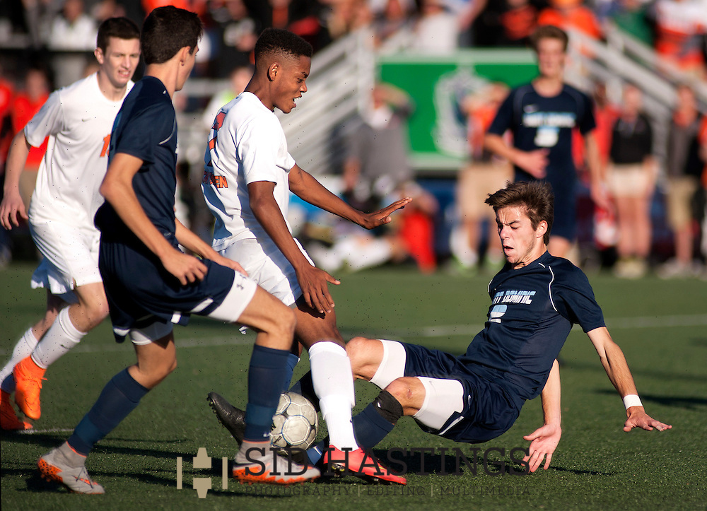 14 NOV. 2015 -- FENTON, Mo. -- St. Dominic High School soccer players Charlie Weston (2) and Jacob Grabenhorst (13) battle Webster Groves' Antoine Givens (7) in front of St. Dominic's goal during the MSHSAA Class 3 state championship game at Soccer Park in Fenton, Mo. Saturday, Nov. 14, 2015. The Crusaders finished second in the state, dropping the game to Webster Groves 3-2. Photo © copyright 2015 Sid Hastings.