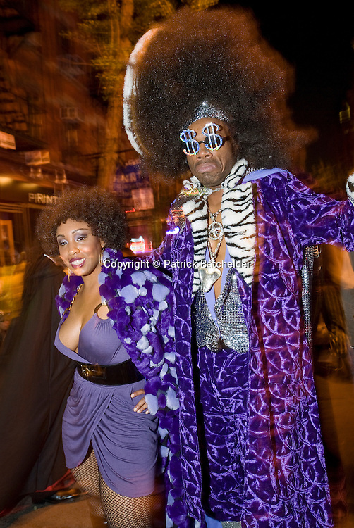 The Halloween Parade on Sixth Avenue in Greenwich Village, New York City, where people gather in outlandish costumes every October 31.