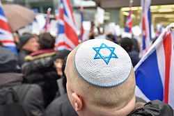 © Licensed to London News Pictures. 08/04/2018. LONDON, UK. A Jewish demonstrator stands at a protest calling for Jeremy Corbyn, leader of the Labour party, to be held to account.  The event was organised by the Campaign Against Anti-Semitism, outside the Labour Party's headquarters in central London.  Photo credit: Stephen Chung/LNP