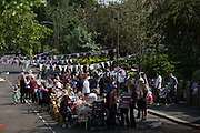 Community street party in Herne Hill, south London celebrating the Diamond Jubilee of Queen Elizabeth. A few months before the Olympics come to London, a multi-cultural UK is gearing up for a weekend and summer of pomp and patriotic fervour as their monarch celebrates 60 years on the throne and across Britain, flags and Union Jack bunting adorn towns and villages.