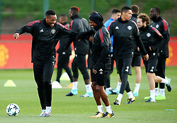 Anthony Martial of Manchester United jokes with Ashley Young during training - Mandatory by-line: Matt McNulty/JMP - 11/09/2017 - FOOTBALL - AON Training Complex - Manchester, England - Manchester United v FC Basel - Press Conference & Training - UEFA Champions League - Group A