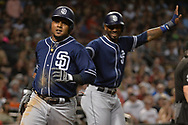 Sep 8, 2017; Phoenix, AZ, USA; San Diego Padres infielder Erick Aybar (8) and  outfielder Jabari Blash (32) celebrate after scoring in the fourth inning against the Arizona Diamondbacks at Chase Field. Mandatory Credit: Jennifer Stewart-USA TODAY Sports
