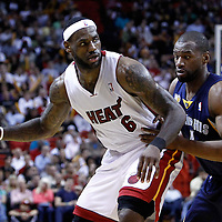 12 March 2011: Memphis Grizzlies shooting guard Sam Young (4) defends against Miami Heat small forward LeBron James (6) during the Miami Heat 118-85 victory over the Memphis Grizzlies at the AmericanAirlines Arena, Miami, Florida, USA. **
