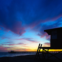 Photo of Lifeguard Tower B and Balboa Pier sunset in Newport Beach California. Newport Beach is a popular coastal beach city along the Pacific Ocean in Orange County Southern California. Copyright ⓒ 2017 Paul Velgos with All Rights Reserved.