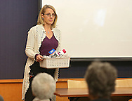 Maria La France of Des Moines holds a basket of her epileptic son's medications as she gives a testimony during a forum about medical cannabis at the Iowa City Public Library in Iowa City on Tuesday, November 19, 2013.