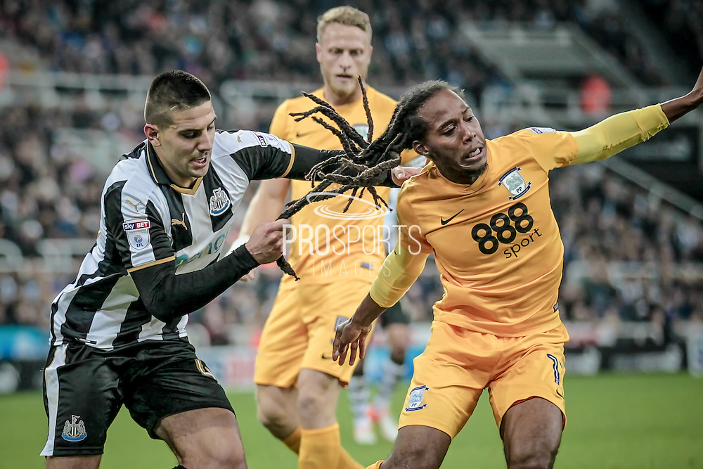 Aleksandar Mitrović (Newcastle United) pulls Daniel Johnson's (Preston North End) hair to stop him getting away from him with the ball during the EFL Cup 4th round match between Newcastle United and Preston North End at St. James's Park, Newcastle, England on 25 October 2016. Photo by Mark P Doherty.