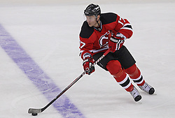 Oct 15; Newark, NJ, USA; New Jersey Devils left wing Ilya Kovalchuk (17) skates with the puck during the third period of their game against the Colorado Avalanche at the Prudential Center. The Avalanche defeated the Devils 3-2.