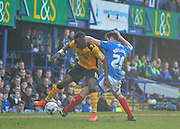 Newport County forward John-Christophe Ayina and Portsmouth midfielder Danny Hollands during the Sky Bet League 2 match between Portsmouth and Newport County at Fratton Park, Portsmouth, England on 12 March 2016. Photo by Adam Rivers.