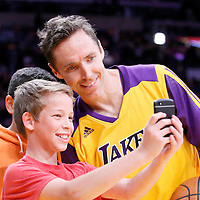 21 March 2014: Los Angeles Lakers guard Steve Nash (10) poses for a selfie with two young Lakers fans during the Washington Wizards 117-107 victory over the Los Angeles Lakers at the Staples Center, Los Angeles, California, USA.