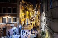 ROME, ITALY - 20 MARCH 2017: White LED street lamps with their glass panes removed are seen here in the foreground, while the yellow street lights in the background hang over the street in the Monti neighborhood in Rome, Italy, on March 20th 2017.<br /> <br /> Rome is undergoing a city-wide plan to change its public illumination from the current yellow sodium street lights CK to white LED lamps. In making the change, Rome joins a long line of cities around the world that have switched to the cheaper, and more environmentally friendly LED lighting, and it is not the first city where that change has come at the price of protest.<br /> <br /> Since July, some 100,000 led lights have already been installed, just over half the number that will be substituted in the 53 million euro changeover that is expected to save the city millions of euros in electrical bills. But when Rome's municipal electrical utility ACEA began to substitute the lamps in Rome's historic center, residents began to take note.