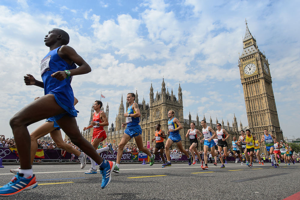 Day 16-The men's marathon runners pass the Palace of Westminster and Big Ben during the London 2012 Olympic Games.