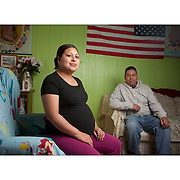 An undocumented couple sit in the living room of their in their south Philadelphia home.
