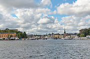 View of Stockholm Sweden skyline seen from the water (Lake Malaren) with focus on Gamla Stan, Stockhom's medieval old town.