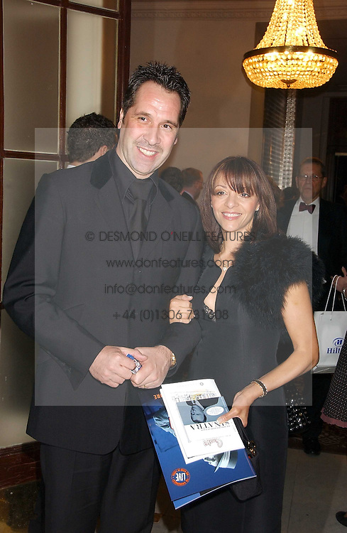 Footballer DAVID SEAMAN and his wife DEBBIE at a party following the world premier of the musican Sinatra at The London Palladium, held at The Palm Court, Waldorf Hotel, Aldwych, London WC2 on 8th March 2006.<br />