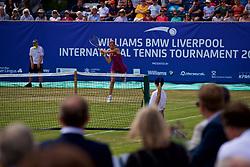 LIVERPOOL, ENGLAND - Saturday, June 23, 2018: Corporate guests watch Alexandra Cadantu (ROU) during day three of the Williams BMW Liverpool International Tennis Tournament 2018 at Aigburth Cricket Club. (Pic by Paul Greenwood/Propaganda)