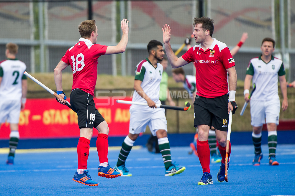 Holcombe's Barry Middleton and Iain Lewers celebrate a goal. Holcombe v Surbiton - Semi-Final - Men's Hockey League Finals, Lee Valley Hockey & Tennis Centre, London, UK on 22 April 2017. Photo: Simon Parker