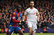 Jordan Henderson and Yannick Bolasie in action during the Barclays Premier League match between Crystal Palace and Liverpool at Selhurst Park, London, England on 6 March 2016. Photo by Michael Hulf.