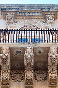 Ancient stone mythical horses and gargoyles on Palazzo Nicolaci di Valladorata in Baroque Noto city, Sicily