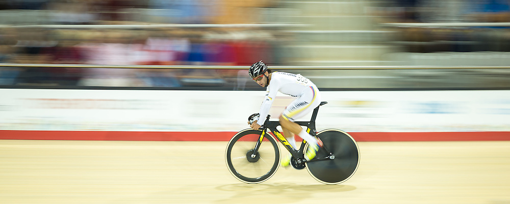 Fernando Gaviria Rendon of Colombia rides close to the railing during the men's cycling omnium points race at the 2015 Pan American Games in Toronto, Canada, July 17,  2015.  AFP PHOTO/GEOFF ROBINS