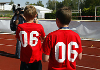 Photo: Chris Ratcliffe.<br />England training session. 07/06/2006.<br />Two young fans wait for England to arrive.