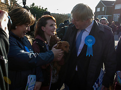 Maria Hutchings, Conservative candidate for Eastleigh and Boris Johnson meet a teenager with her dog, Eastleigh, UK, 20 February, 2013. Photo by: i-Images