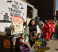 """Sister Donna Hosmer lines up her students for their """"Terror"""" Nova Testing during Holy Trinity School's Trunk or Treat on Monday afternoon. (Karen Bobotas/for the Laconia Daily Sun)"""