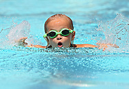 Elmcrest Country Club's Jane Petersen, 7, competes in the Girls 8 & Under 25 Yard Butterfly event at the All City Swim Meet at Cherry Hill Aquatic Center in Cedar Rapids on Saturday, July 20, 2013. 623 athletes from ages 4-17 participated in the meet.