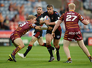 Huddersfield Giants stop Tony Clubb of Wigan Warriors during the Betfred Super League match at the John Smiths Stadium, Huddersfield<br /> Picture by Richard Land/Focus Images Ltd +44 7713 507003<br /> 12/07/2018