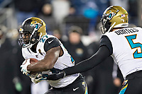 NASHVILLE, TN - DECEMBER 31:  Blake Bortles #5 hands off the ball to Leonard Fournette #27 of the Jacksonville Jaguars during a game against the Tennessee Titans at Nissan Stadium on December 31, 2017 in Nashville, Tennessee.  The Titans defeated the Jaguars 15-10.  (Photo by Wesley Hitt/Getty Images) *** Local Caption *** Blake Bortles; Leonard Fournette