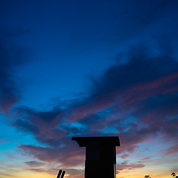Newport Beach Lifeguard Tower B silhouette sunset photo. Newport Beach California is a popular beach city along the Pacific Ocean in Orange County CA. Photo is high resolution. Copyright ⓒ 2017 Paul Velgos with All Rights Reserved.