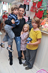 LIBERTY ROSS with her children SONNY (Tennyson) & SKYLA and Liberty's nephew LUDO ROSS (in yellow) at the opening of the new HoneyJam children's store at 2 Blenheim Crescent, London W11 on 7th July 2011.