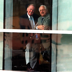 10-28-99-26-DALY#3--KEITH BIRMINGHAM--TRIB<br /> LOS ANGELES: The Los Angeles Dodgers held a press conference at the new Staples Center in Downtown Los Angeles to name Robert Daly former Warner Bros. head to become the managing Partner and acquire a minority stake in the Dodgers, Tommy Lasorda, former Dodgers manager stands with Vin Scully.